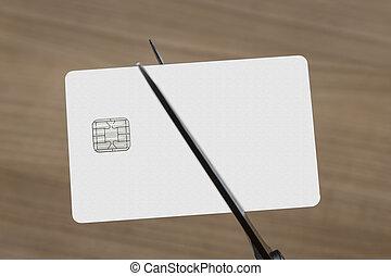 scissors cutting a credit or debit card