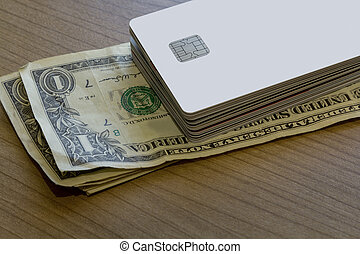 Batch of Credit or Debit Card on Dollar Notes - A Batch of...