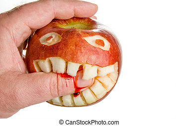 Biting Apple - An apple biting the hand that eats it