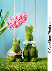 Easter bunnies with hyacinth - Two Ester bunnies with a pink...