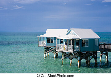 Hotel cabanas, Bermuda - Hotel cabanas standing on stilts in...