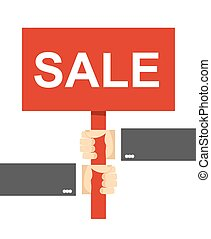 hands holding a sign. Sale