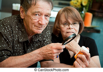 Senior man and woman with medications