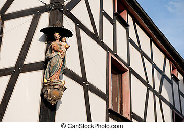 Timber framing house with religious statue - Timber framing...
