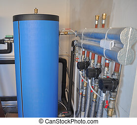 Geothermal heating - Water tanks in a geothermal heating...