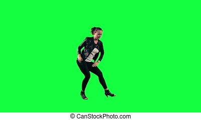 Dancer against a green background - Young woman dancing...