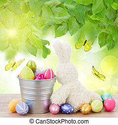 egg hunt with easter bunny - easter rabbit with metal pot...