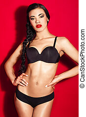 Woman in lingerie with sexy body - Portrait of hispanic...