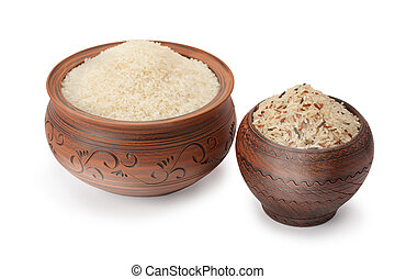 clay pots with rice isolated on white background