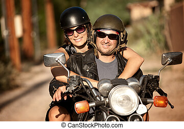 Man and Woman on Motorcycle - Man and Woman riding on...