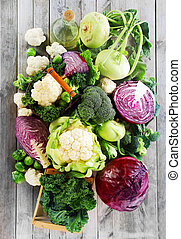 Assorted Fresh Vegetables on Wooden Table - Close up...
