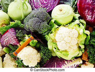 Background of healthy fresh cruciferous vegetables with...