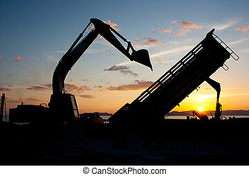 track-type loader excavator machine doing earthmoving work...