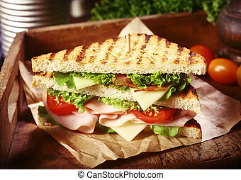 Grilled Clubhouse Sandwich with Fresh Toppings - Close Up of...
