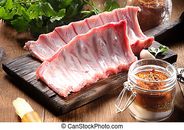 Pork Rib Meat on Wooden Board with Spicy Powder - Close up...