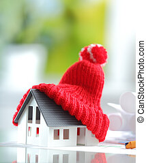 Energy saving Red Knitted Hat on Miniature House - Energy...