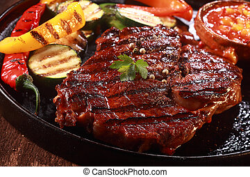 Grilled Steak on Cast Iron Pan with Vegetables - Close Up of...
