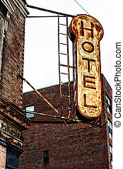 Hotel Sign - Old, decrepit, weathered sign for a hotel