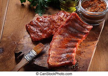 Fried Pork Rib on Cutting Board with Spicy Powder - Close up...
