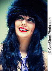 Woman in fur cap - Portrait of smiling woman in fur cap