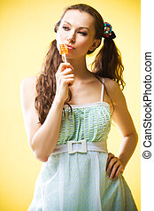 Candy girl - Beautiful young girl with candy