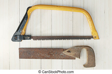 Old saws on wood background.