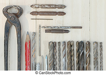 Carpenter tools on plank wood background