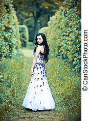 Nymph - Beautiful young woman in elegant dress in dramatic...