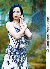 Nymph - Beautiful young woman in magic garden