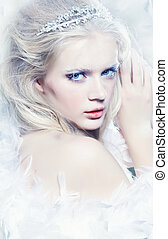 Winter queen - Beautiful christmas princess in feathers