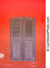 the window on red wall
