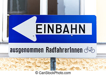 one way road sign with additional, except for cyclists