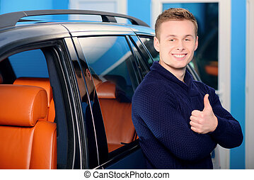 Happy handsome man near his car - It is the best car ever....
