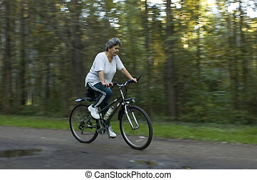 woman on bicycle in park