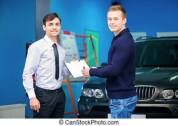 Car owner signing a service order