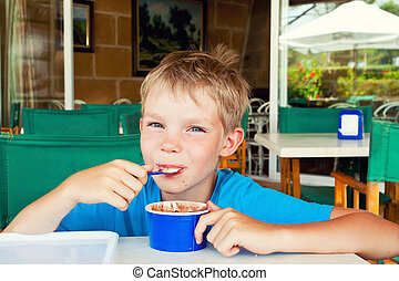 Boy eating ice cream - Cute boy eating ice cream in Spanish...