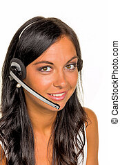 woman with headset - a young woman in a customer phoned...