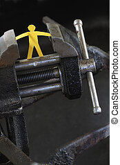 Under Pressure - Small yellow paper man under pressure with...