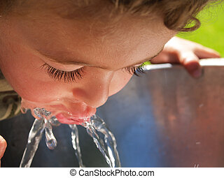 Boy at drinking fountain - Boy at drinking fountain, sipping...