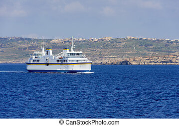 Malta ferry boat with Gozo island on background