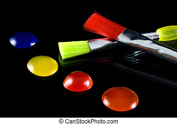 Artist Paint and Brushes on a black background