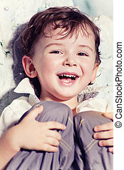 Laughing boy - Portrait of cute laughing little boy