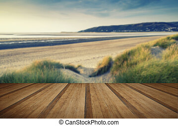 Summer evening landscape view over grassy sand dunes on...