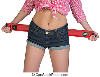 Woman holding builders level - Woman holding builder's level...