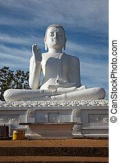 Sitting Buddha image - White sitting Budha image. Mihintale,...