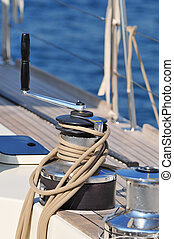 Winch - Close-up of winch with rope of a sailboat