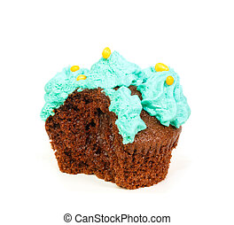 Cupcake with blue frosting of which one bite taken