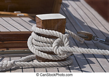 Moored boat - Close-up of a rope fasten to a wooden bitt
