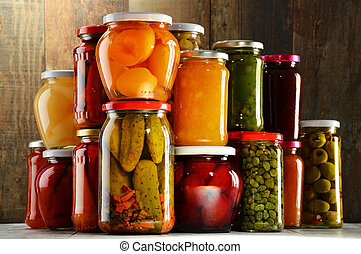 Jars with pickled vegetables, fruity compotes and jams...