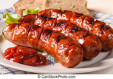 Grilled sausage. - Grilled sausage on a plate.